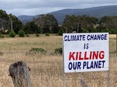 Sign in farmer's field, Tasmania, Australia